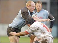 Blues centre Tom Shanklin is tackled by Ulster's David Humphreys