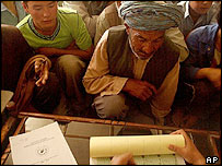 Men getting voter registration cards