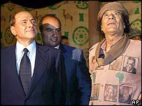 Italian Prime Minister Silvio Berlusconi (left) and Colonel Muammar Gaddafi (right)