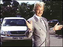 Smooth-talking car salesman Swiss Toni, played by Charlie Higson