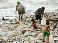 Scavengers collecting rubbish after storms in Manila