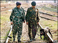 Indian soldiers examine railway tracks in Assam