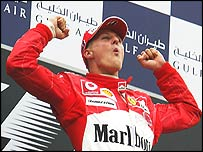 Michael Schumacher celebrates his victory in the Bahrain Grand Prix