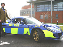 Ansar Ali, General Manager of Lotus Cars Ltd. in the UK with Chief Constable Andy Hayman (in the car) at Wymondham Police Headquarters