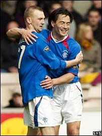 Stephen Hughes is congratulated by Michael Mols