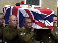 Colleagues carry Private Ferns' coffin at the church