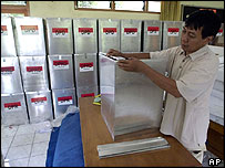 Election official prepares ballot boxes