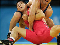South Korea's Jung Ji-hyun (red) fights Bulgarian Armen Nazarian in the semis