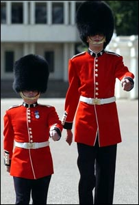 5ft 2 in Matthew Else with 7ft 3 in Martyn Walters, the smallest and tallest soldiers in the Irish Guards