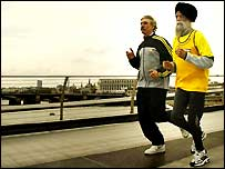London Marathon race director David Bedford gets in some practice with Fauja Singh