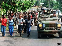 Ethnic Hutu troops from Rwandan government forces, and French patrol in June 1994