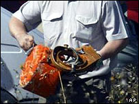 Investigator carries flight recorder from crash site in Tula, Russia