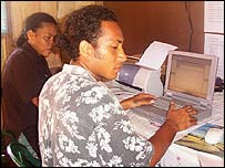 Users at a PeopleFirst e-mail station