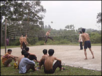 Men from Pingling Village play volleyball
