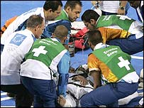 Olympic medical teams rush to help the unconscious athlete