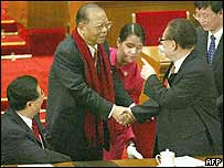 Hong Kong's standing committee member Tsang Hin-chi (left) shakes hands with former Chinese President Jiang Zemin (right)