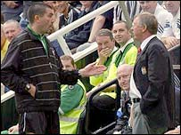 Fourth official Jeff Winter sends Sir Alex Ferguson from the touchline