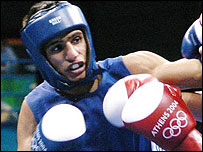 Amir Khan connects with a blow during his semi-final win