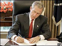 US President George W Bush signs a series of executive orders on 27 August 2004