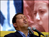 Venezuelan leader Hugo Chavez sings the national anthem