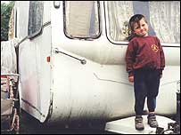 Caravan with small boy standing outside