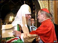 Russian Patriarch Alexy (L) greets Cardinal Walter Kasper of the Vatican