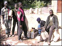 Men collecting water