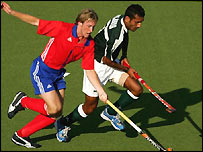 Tom Bertram and Dilawar Hussain in action for Great Britain and Pakistan