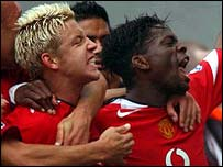 Manchester United strikers Alan Smith and Louis Saha celebrate their equaliser