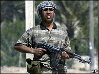 Armed Shia militiaman in Baghdad