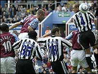 Olof Mellberg heads Aston Villa in front against Newcastle