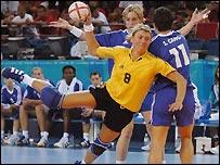 Ukraine's Olena Radchenko shoots during their bronze medal match