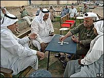 Men play dominoes in Baghdad