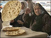 Women prepare bread in Iraq
