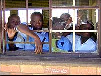 students peeping from broken windows