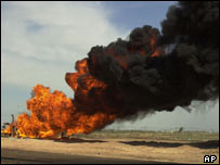 An oil pipeline burns in Tikrit after an attack by saboteurs