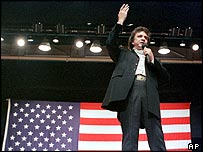 Johnny Cash in front of Stars and Stripes