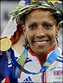 Kelly Holmes celebrates with her 1500m gold medal