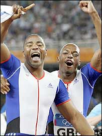 Mark Lewis Francis (left) and Marlon Devonish celebrate Britain's win