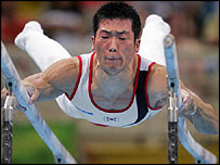 Yang Tae-young competes in the parallel bars