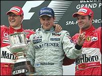 Michael Schumacher, Kimi Raikkonen and Rubens Barrichello celebrate on the podium