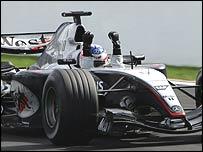 Kimi Raikkonen celebrates victory in Belgium