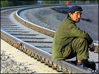 A railway worker takes a rest