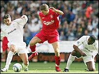 Steven Gerrard, like Liverpool, was kept in check by Bolton whose Gary Speed (left) and Bruno N'Gotty close the visitors' midfielder down