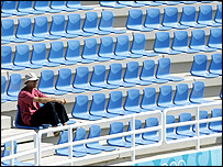A sole spectator at the tennis