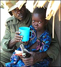 Ugandan soldier with child