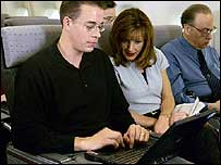 Man and woman use the in-flight internet service