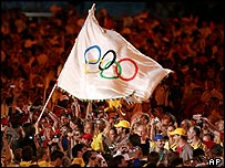 Athletes waving Olympic flag