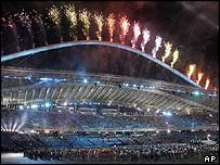 Athletes and spectators take in fireworks at the closing ceremony for the Summer Olympics in Athens