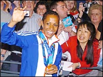 Kelly Holmes greeted by crowds at Gatwick